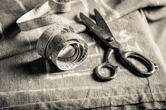 Sewing table with scissors and cloth Royalty Free Stock Image