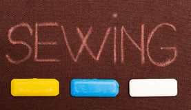 Sewing text underlined by tailoring chalks royalty free stock photos
