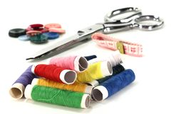Sewing thread. Colorful spools of thread and sewing on a white background Stock Photo