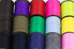 Sewing thread. Sewing thread of many colors on a white background Stock Photos