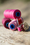 Sewing thread on the balance beam. With a blurred background Stock Photo