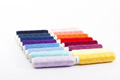 Sewing thread colors. A sewing thread colors over white background Stock Image