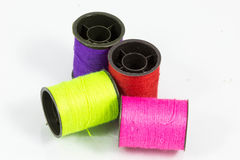 Sewing thread colors. Sewing thread color on a white background Royalty Free Stock Photo
