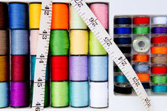Sewing - Thread - Cotton Reels and Bobbins with tape measure Stock Photos