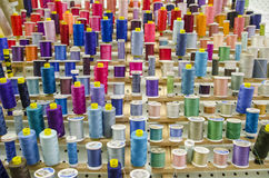 Sewing thread. Display of assorted colored thread on spools Stock Image