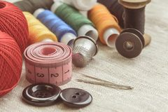 Sewing thread and for knitting, composition of seamstress. Composition of seamstress, tailor, thread for sewing and for knitting stock photos