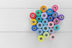 Sewing thread on a light wooden background. Sewing thread on the light wooden background Royalty Free Stock Photo