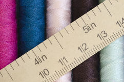 Sewing thread and measuring tape background Stock Images