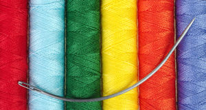 Sewing Thread and Needle. Closeup of different colored sewing thread with circular mattress needle on top Stock Photography