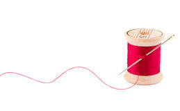 Sewing thread and needle. On white Royalty Free Stock Photos