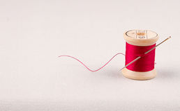 Sewing thread and needle Stock Photo