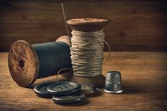 Sewing thread, needle and buttons Royalty Free Stock Image