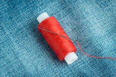 Sewing thread and needle Stock Image