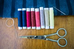 Sewing thread and needle stock images