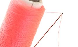 Sewing thread with needle. Isolated on a white background stock photos
