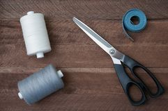 Sewing thread scissors and tailor meter stock photography