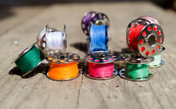 Sewing thread. Spool of thread, red, blue, green, needle and thread Royalty Free Stock Photo