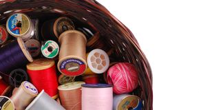 Sewing Thread  Wicker Basket. Spools of sewing thread of varying sizes and colors in a wicker basket Stock Images