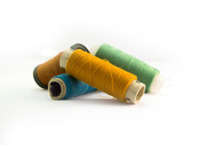 Sewing Threads. Four Color pile of sewing threads Royalty Free Stock Photography