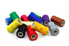 Sewing threads. Colorful sewing threads on white background Royalty Free Stock Images