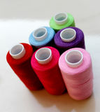 Sewing threads as a multicolored background Stock Image