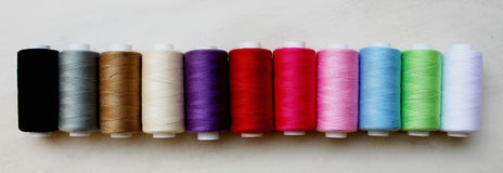 Sewing threads as a multicolored background Stock Photography