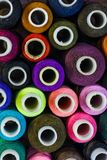 Sewing threads in assortment close-up on the shelf. Stock Photos