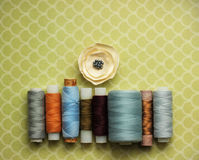 Sewing threads. Colorful sewing threads and flower Royalty Free Stock Photography