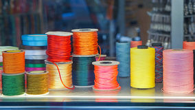 Sewing threads. Colorful sewing threads and yarns at spools Royalty Free Stock Photos