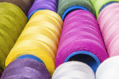 Sewing Threads in foreground Royalty Free Stock Photo