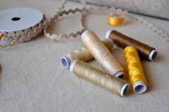 Sewing Threads on a Linen Fabric Background Stock Images