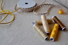 Sewing Threads on a Linen Fabric Background Stock Photos