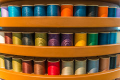 Sewing threads multicolored background closeup royalty free stock images