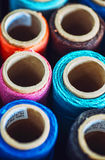 Sewing threads multicolored background closeup texture Stock Images