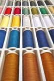 Sewing threads multicolored background closeup Stock Photos