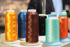 Sewing threads multicolored on spool. Sewing threads multicolored background closeup Threads on spool Royalty Free Stock Image