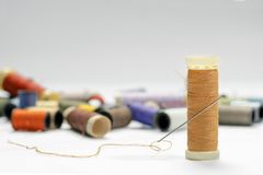 Sewing threads and needle. On a white background Royalty Free Stock Photos