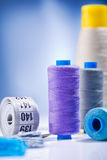 Sewing threads and roll of tape Stock Photos