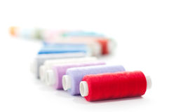 Sewing threads row Stock Photos