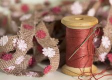 Sewing threads spool with sewing needle,embroidery background stock image
