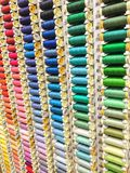 Sewing threads spools multi colored background Stock Photo
