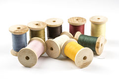 Sewing threads on wooden spools Royalty Free Stock Photo
