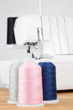 Sewing threads on wooden table Royalty Free Stock Images