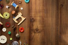 Sewing tools and accessories on wood Royalty Free Stock Images