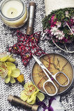 Sewing tools and floral decorations Royalty Free Stock Image