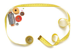 Sewing tools and measuring tape on white Stock Photo