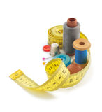 Sewing tools and measuring tape on white Stock Image