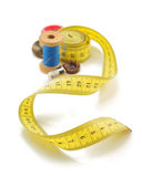 Sewing tools and measuring tape on white Royalty Free Stock Photo