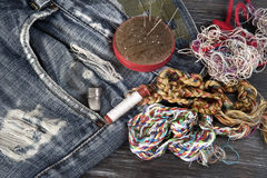Sewing tools. On old jeans royalty free stock image