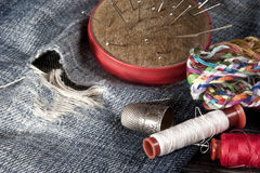 Sewing tools. On old jeans stock image